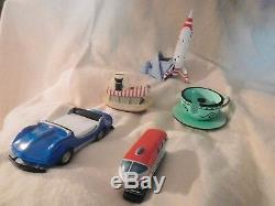 Disney Jungle Cruise, Moonliner, Tea cup, Autopia car and Monorail. Desk set