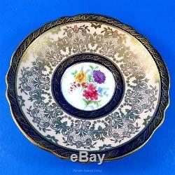 Rich Gold with Cobalt Trim and Floral Center Paragon Tea Cup and Saucer Set