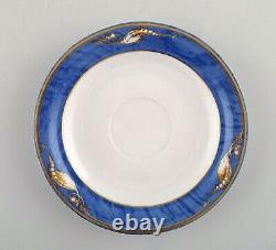 Royal Copenhagen. Set of six Magnolia tea cups with saucers and six plates